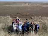 The group atop a high sand dune near the Paradise car park which gave us fine views out across the marshland to the sea.